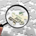 us dollar puzzle and magnifier