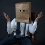 bag-over-head-embarrassed-shame-businessman